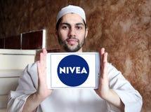 Nivea logo. Logo of beauty and cosmetics company nivea on samsung tablet holded by arab muslim man stock photo