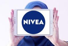 Nivea logo. Logo of beauty and cosmetics company nivea on samsung tablet holded by arab muslim woman royalty free stock photo