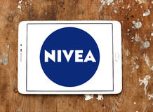 Nivea logo. Logo of beauty and cosmetics company nivea on samsung tablet on wooden background Royalty Free Stock Images