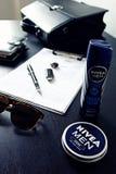 Nivea manprodukter på ett skrivbord Royaltyfria Bilder