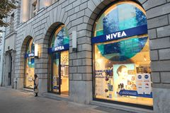 Nivea store. BERLIN, GERMANY - AUGUST 26, 2014: Person exits Nivea store in Unter den Linden, Berlin. Nivea is a brand of Beiersdorf, German personal care Stock Images