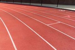Niveau en caoutchouc de voie courante de stade d'athlétisme images libres de droits