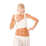 Nivel de medición de la grasa de la mujer apta en su cintura Imagenes de archivo