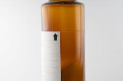 Nivel seco de la demostración de la botella del jarabe del polvo de mezclado Fotografía de archivo