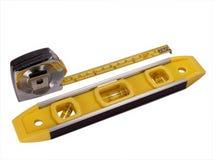 Nivel y cinta métrica Foto de archivo libre de regalías
