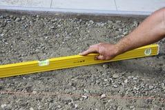 Nivelando a terra para pavimentar foto de stock royalty free