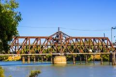 Niveles de Rusty Iron Bridge With Two Imágenes de archivo libres de regalías