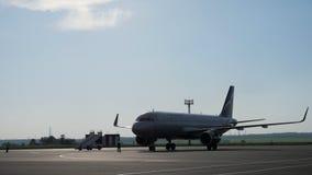 Nizhnekamsk, Russia, 25-05-2019: Ground staff prepare plane to flight in runway.