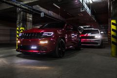 Nizhnevartovsk, Russia - August 24, 2016: Two Jeep Grand Cherokee SRT. Red and white, front side view stock photography