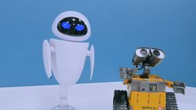 Wall-e and Eva robots at technology exhibition stock video footage