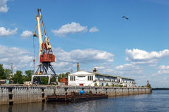 Nizhny Novgorod cargo river port on the Strelka in 2016. Warehouses and port crane in cargo river port of Nizhny Novgorod on the Strelka. View from the Oka River Stock Images