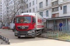Nizhny Novgorod, Russia. - April 14.2016. Cargo fura drove backwards to the rear entrance of the store MAGNET. Unloading goods. Street Sovnarkomovskaya 26 stock photography