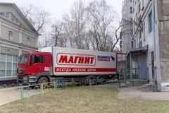 Nizhny Novgorod, Russia. - April 14.2016. Cargo fura drove backwards to the rear entrance of the store MAGNET. Unloading goods. Street Sovnarkomovskaya 26 stock images