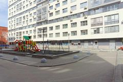 Nizhny Novgorod, Russia. - April 26.2016. Outfitted yard area with a children's playground on the street Nevzorov 64. Royalty Free Stock Photos