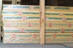 Packed board made of wood `euro standard`, prepared for sale in the construction market. stock image