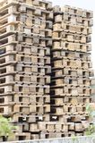 Wooden boards made of pine, edged and not edged, lie on racks and in piles for sale in the open air market. stock images