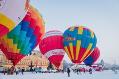 Mass-start on the festival of hot air ballons. NIZHNY NOVGOROD, RUSSIA - FEBRUARY 24, 2018. Mass-start on the festival of hot air ballons Royalty Free Stock Photography