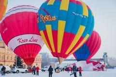 Mass-start on the festival of hot air ballons. NIZHNY NOVGOROD, RUSSIA - FEBRUARY 24, 2018. Mass-start on the festival of hot air ballons Royalty Free Stock Image
