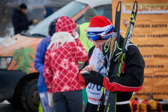 NIZHNY NOVGOROD, RUSSIA - FEBRUARY 11, 2017: Ski Competition Russia 2017. Winter sports. Family championship. Skier with phone Stock Photo