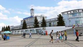 Nizhny Novgorod, Russia, tourists stroll on the square at the river station. Nizhny Novgorod, Russia - July 14, 2019: River station on the embankment of the stock video