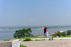 Nizhny Novgorod, Russia. - July 28.2016. Young girls photographers photographed view of the intersection of the rivers Oka and Vol Royalty Free Stock Photo