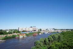 Nizhny Novgorod, Russia. - June 28.2016. View from the metro bridge across the Oka River to the island and a low bank of the river Royalty Free Stock Photo