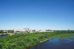 Nizhny Novgorod, Russia. - June 28.2016. View from the metro bridge across the Oka River to the island and a low bank of the river Stock Photography