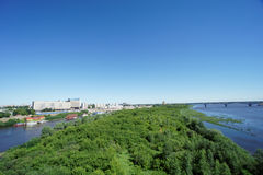 Nizhny Novgorod, Russia. - June 28.2016. View from the metro bridge across the Oka River to the island and a low bank of the river Stock Image