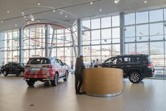 Cars and customer in showroom of dealership Toyota in Nizhny Novgorodcity in 2018 stock image