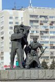 Nizhny Novgorod, Russia. - March 14.2017. The sculptural group is a worker, a soldier and a collective farmer near the pedestal wi Stock Photos