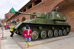 Nizhny Novgorod, Russia - May 3.2013. Children playing on the self-propelled artillery SU-76 Royalty Free Stock Images