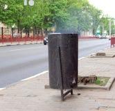 Nizhny Novgorod, Russia. - May 20.2016. On the street in a trash burning trash. Royalty Free Stock Photos