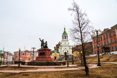 Nizhny Novgorod, Russia. Minin and Pozharsky monument. Near Kremlin during the cloudy day in Nizhny Novgorod, Russia. Trees and historical buildings Stock Images
