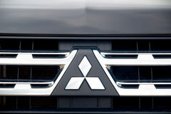 Nizhny Novgorod, Russia - September 14, 2016: The black bonnet, radiator grille logo of the Mitsubishi Pajero Sport Car Royalty Free Stock Photos