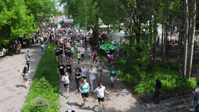 NIZHNY NOVGOROD, RUSSIAN FEDERATION - MAY 2015: Marathon, Street Runners In Spring Day. Charity Run, Amount of People. Running In The Park, Aerial Shot, HD stock footage