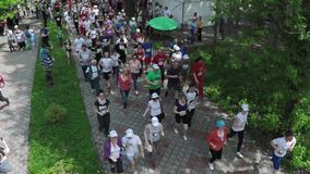 NIZHNY NOVGOROD, RUSSIAN FEDERATION - MAY 2015: Marathon, Street Runners In Spring Day. Charity Run, Amount of People. Running In The Park, Aerial Shot, HD stock video footage