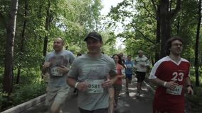 NIZHNY NOVGOROD, RUSSIAN FEDERATION - MAY 2015: Marathon, Street Runners In Spring Day. Charity Run, Amount of People. Running In The Park, HD stock video