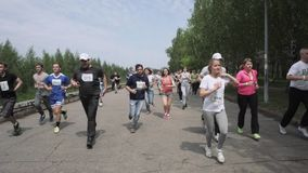 NIZHNY NOVGOROD, RUSSIAN FEDERATION - MAY 2015: Marathon, Street Runners In Spring Day. Charity Run, Amount of People. Running In The Park, HD stock video footage