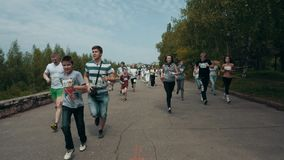NIZHNY NOVGOROD, RUSSIAN FEDERATION - MAY 2015: Marathon, Street Runners In Spring Day. Charity Run, Amount of People. Running In The Park, HD stock footage