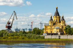 Nizhny Novgorod, Strelka. Alexander Nevsky Cathedral, port and construction cranes Royalty Free Stock Photography