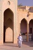 NIZWA, OMAN - FEBRUARY 2, 2012: An Omani old man traditionally dressed in Nizwa Old Town. An Omani old man traditionally dressed in Nizwa Old Town Stock Images