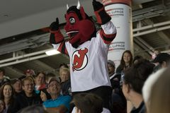 NJ Devil. The mascot of the New Jersey Devils roams the crowd during Kraft Hockeyville royalty free stock photos