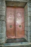 Njegos mausoleum entrance door. LOVCEN, MONTENEGRO - AUGUST 11, 2015: Njegos mausoleum entrance door, is a work of art by famous sculptor Ivan Mestrovic Royalty Free Stock Image