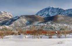 Njegushi village after a snowfall. Montenegro Stock Image