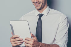 Njoying his new digital tablet. Royalty Free Stock Images