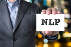 NLP letters (or Neuro Linguistic Programming) on the card shown Stock Image
