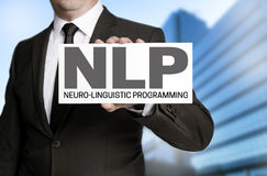 Nlp sign is held by businessman Royalty Free Stock Image