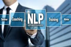 NLP touchscreen is operated by businessman Royalty Free Stock Images