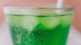 Nmacro photo of a soda with ice cubes in a glass close-up. Macro photo of a soda with ice cubes in a glass close-up Royalty Free Stock Images