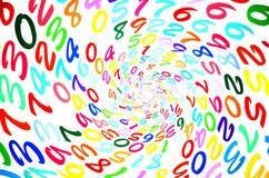 Números al azar coloridos en una forma espiral Fotografía de archivo